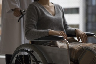 Doctors to push the wheelchair patient